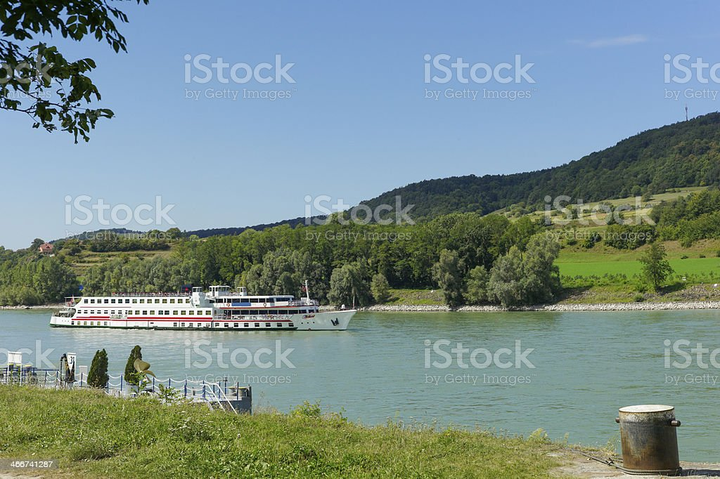 Tourboat cruising at danube river near melk city of austria stock photo