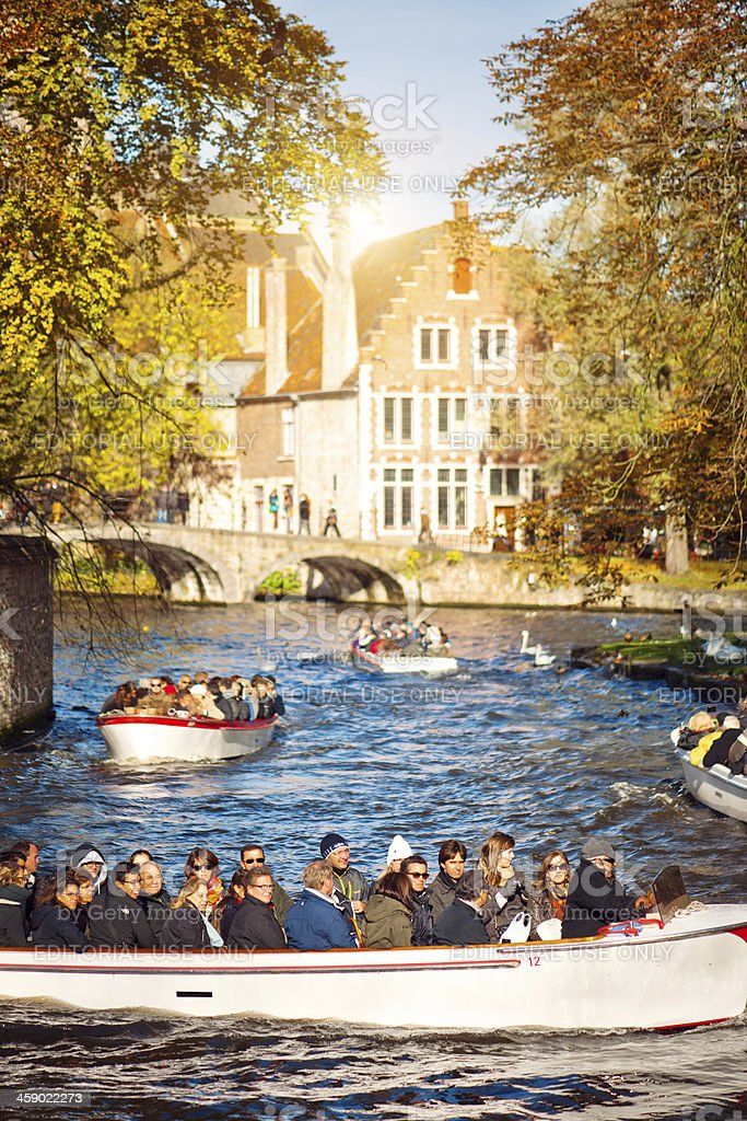 Tourboat with tourists, Bruges royalty-free stock photo