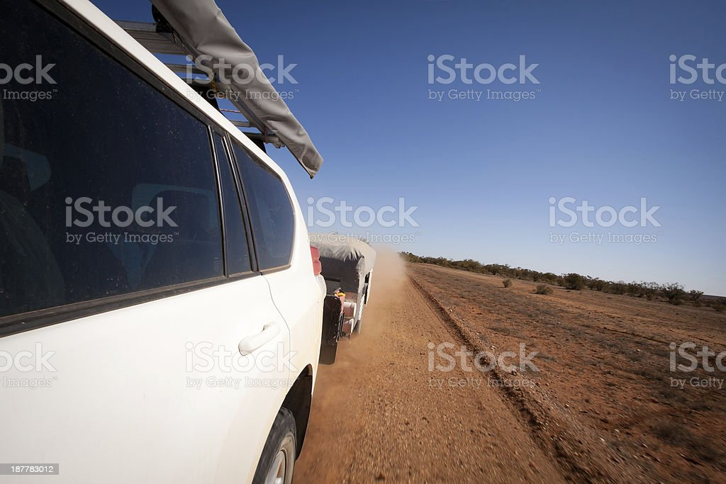 Touring Outback Australia - Four Wheel Drive Towing Camper Trailer royalty-free stock photo