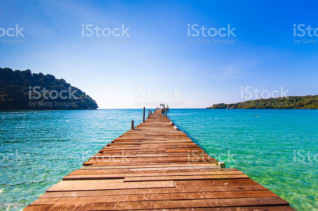 Tourism Concept. Old wooden pier. paradise island stock photo