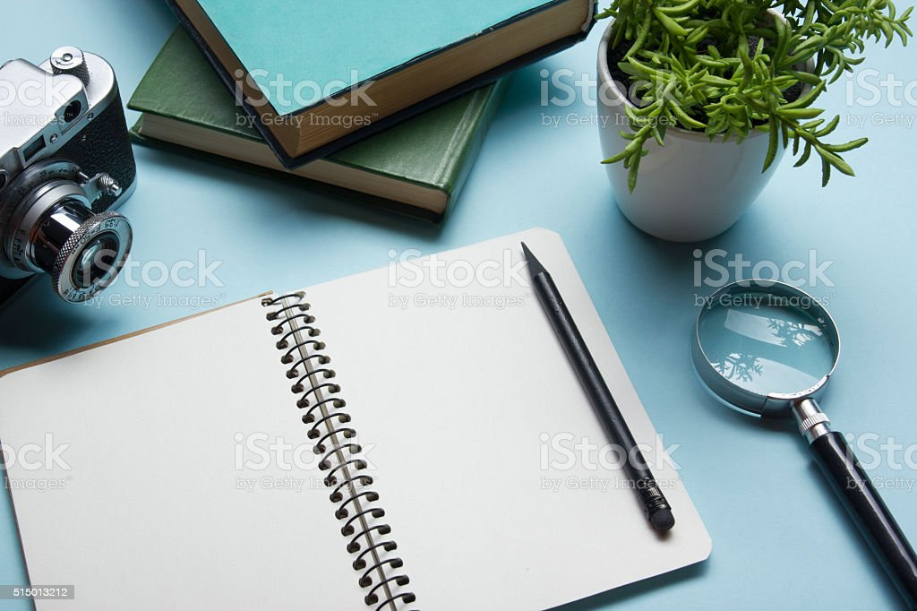 Tourism, travel concept. Office desk table with notepad, camera and stock photo