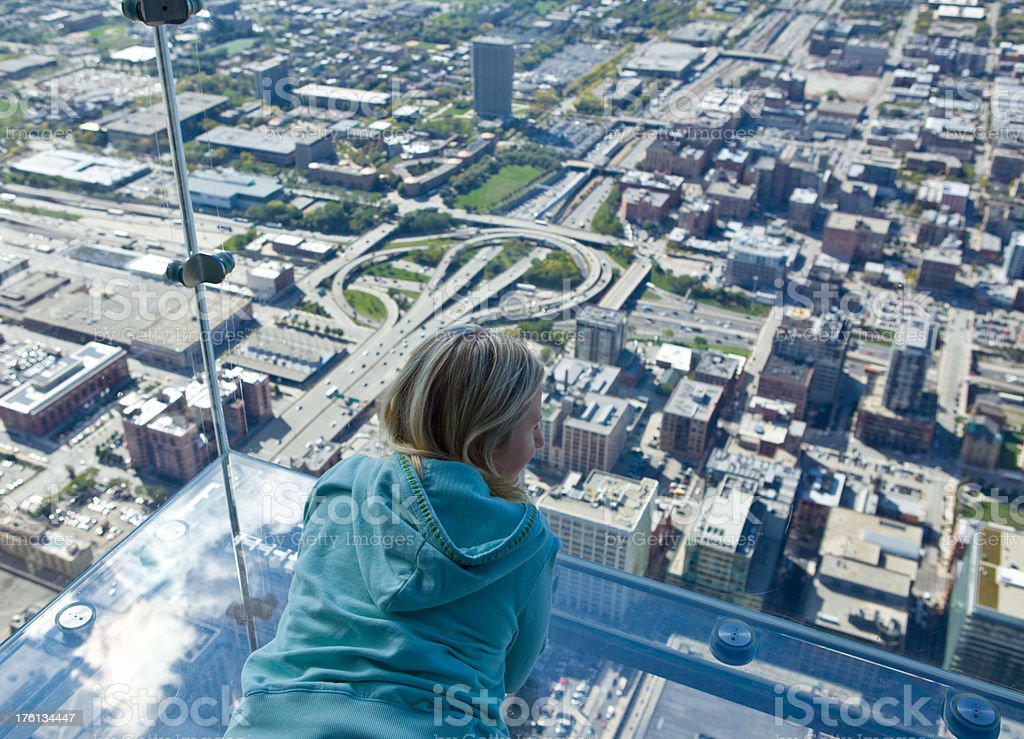 Tourist admiring view of Chicago from Sears Tower stock photo