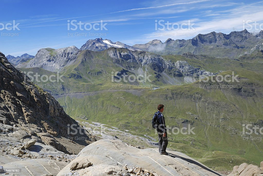 Tourist against the green mountains. stock photo