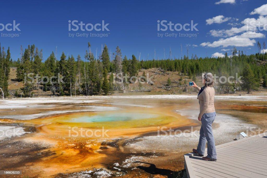 Tourist and Chromatic Pool, Yellowstone stock photo