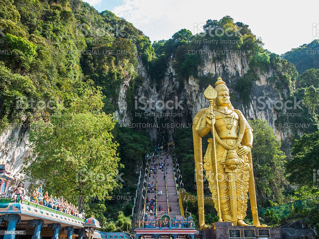 Tourist and Lord Murugan Statue in front the batu cave stock photo