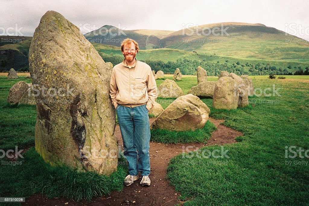 Tourist at Castlerigg stone circle, Lake District, England, ancient, mysterious stock photo