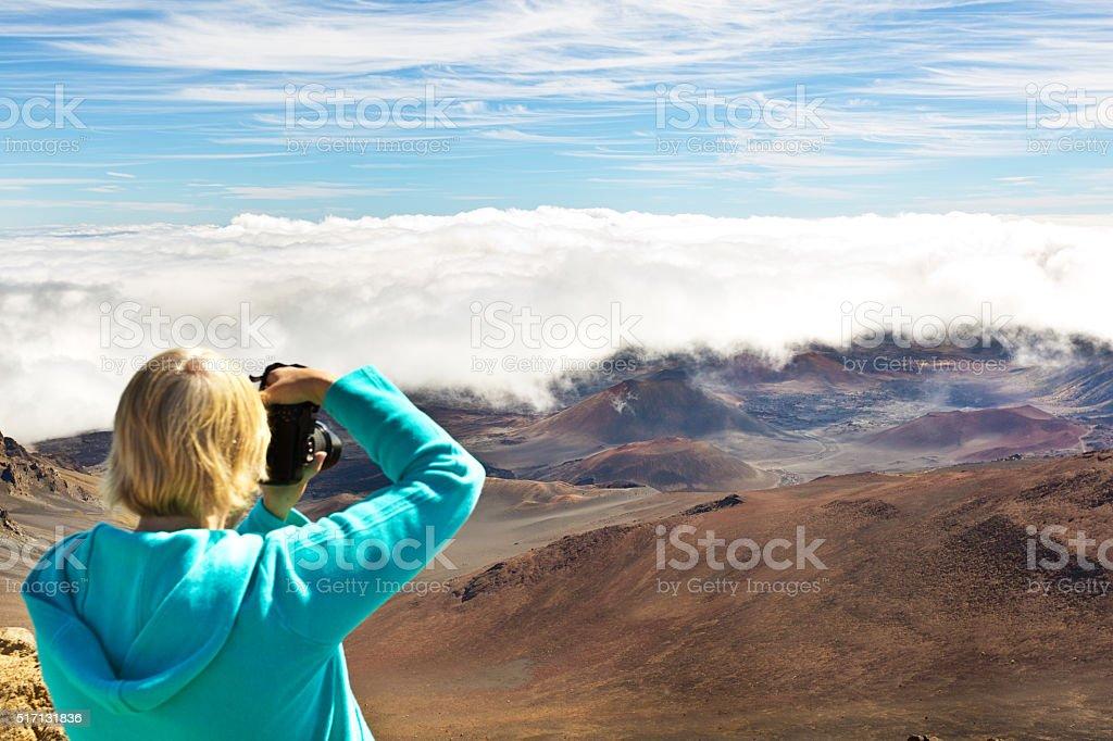 Tourist at Haleakala National Park Crater in Maui Hawaii stock photo