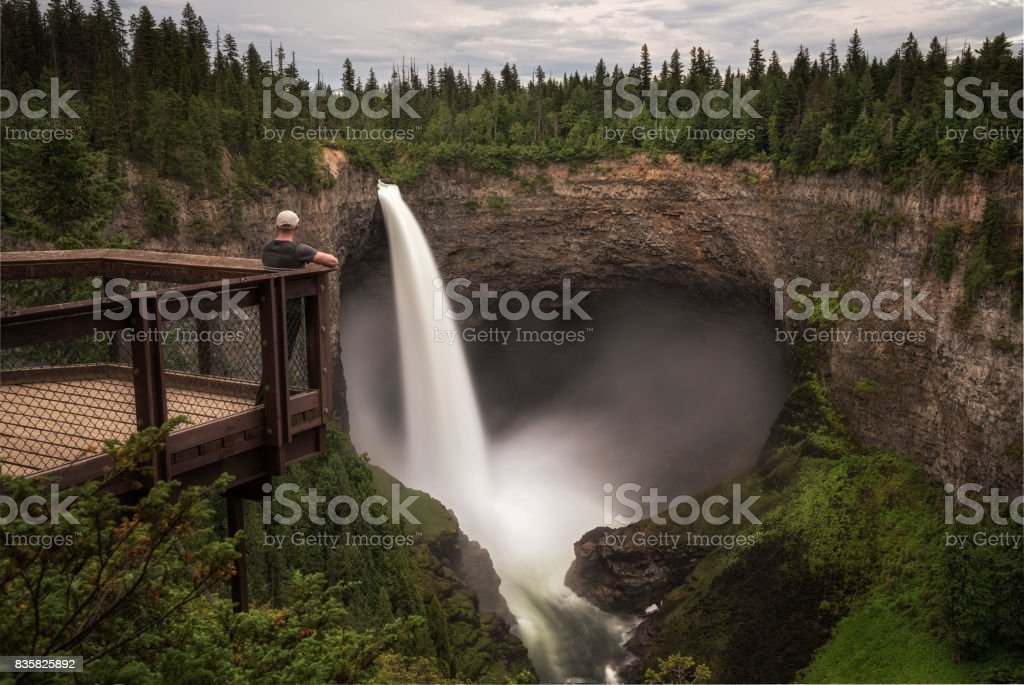 Tourist at Helmcken Falls in Wells Gray Provincial Park in Canada stock photo