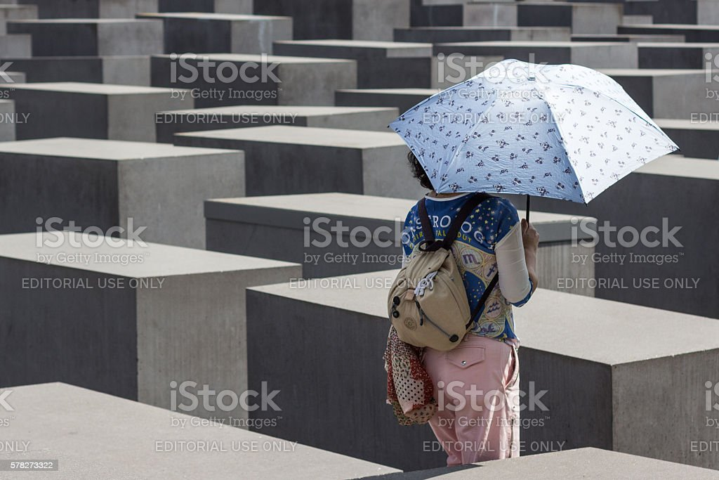 Tourist at Holocaust memorial / jewish memorial in Berlin stock photo