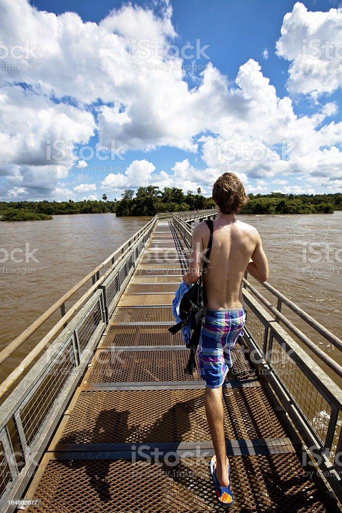 Tourist at Iguazu falls stock photo