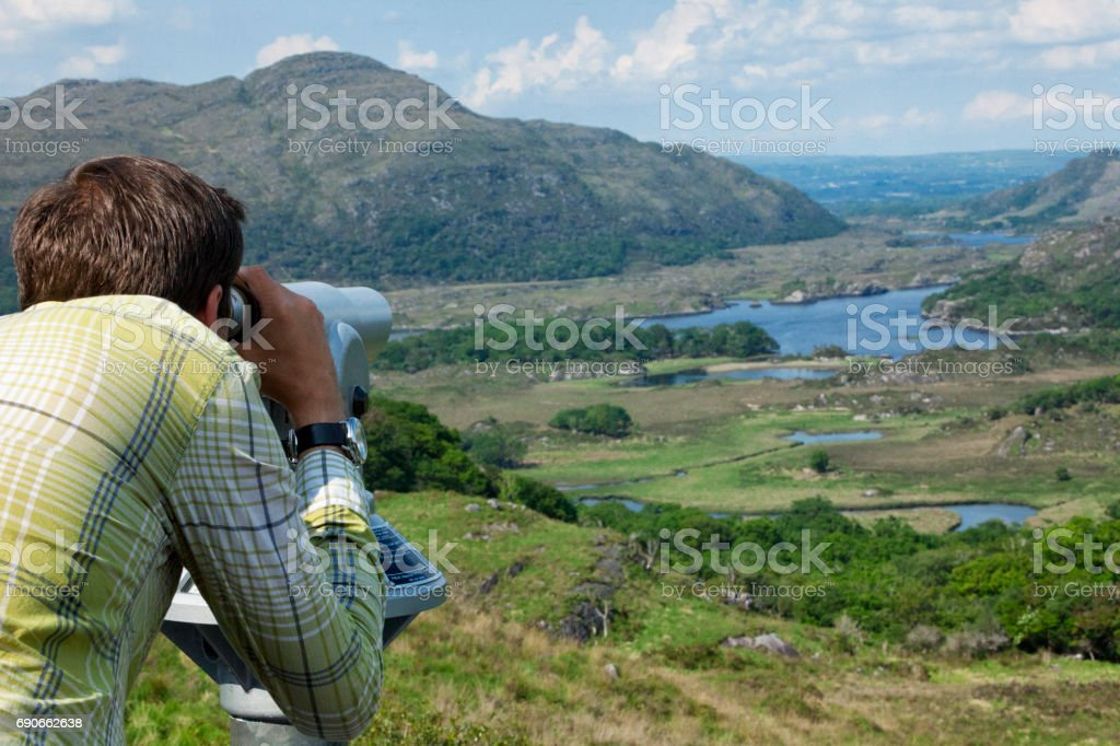 Tourist at Ladies View on the Ring of Kerry, Ireland stock photo