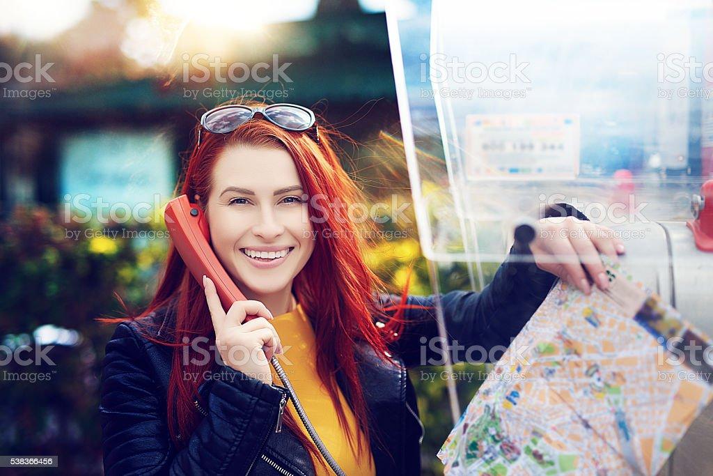 tourist at public phone stock photo