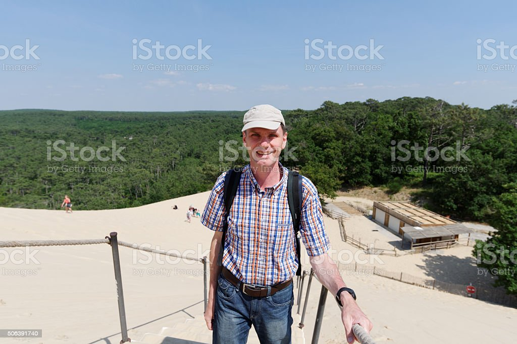 Tourist at the dune of Pilat, France stock photo