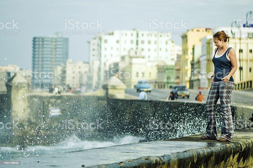 Tourist at the famous Malecon, Havana stock photo