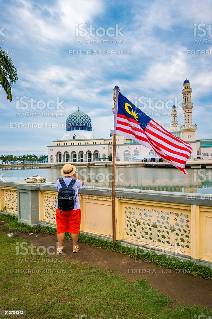 Tourist at the Kota Kinabalu city mosque, Malaysia stock photo