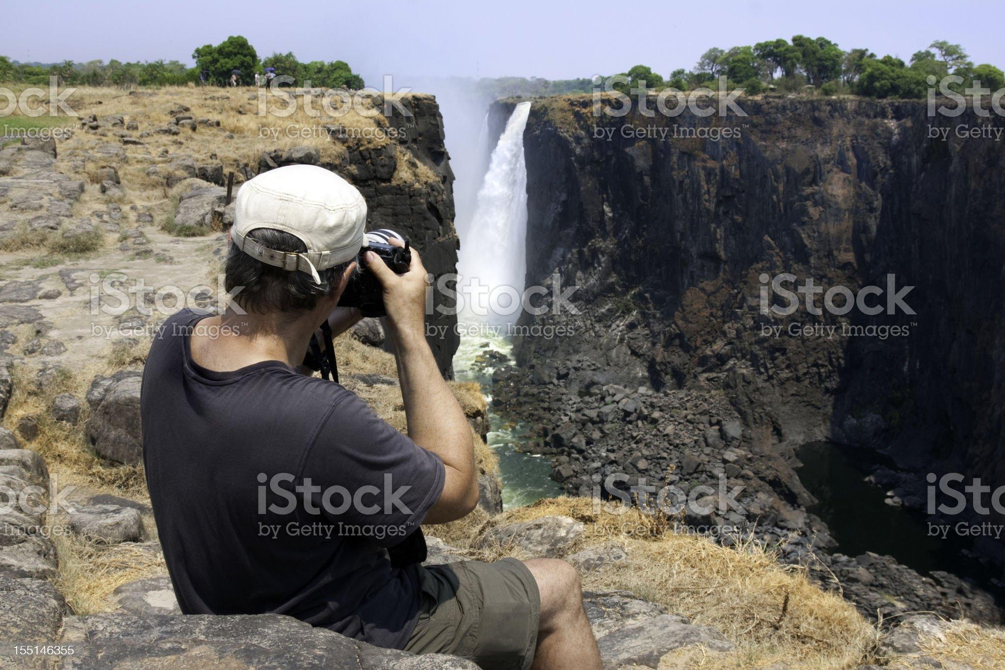 Tourist at Victoria Falls royalty-free stock photo