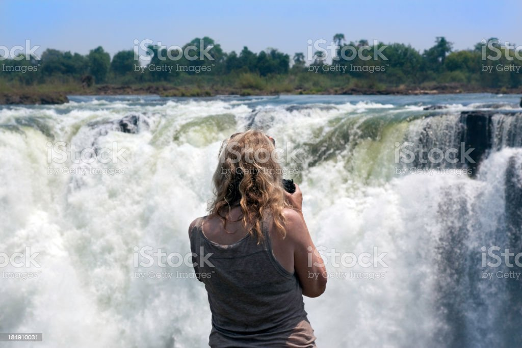 Tourist at Victoria Falls royalty-free stock photo