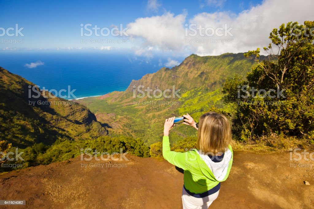 Tourist at Waimea Canyon Kalalau Beach, Kauai, Hawaii stock photo