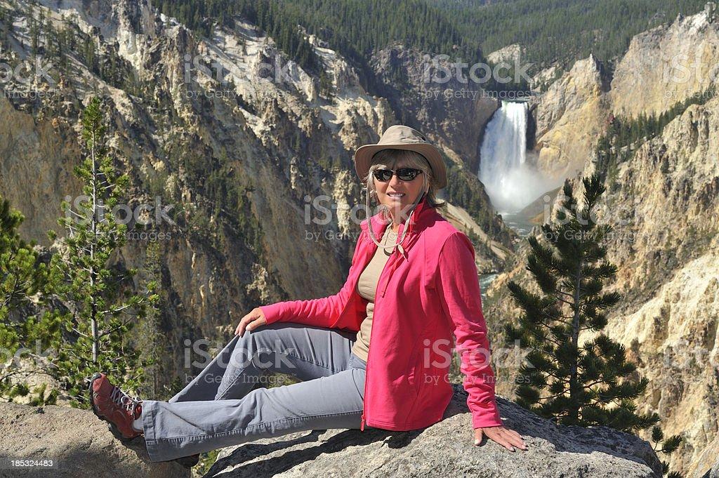 Tourist at Yellowstone waterfall stock photo