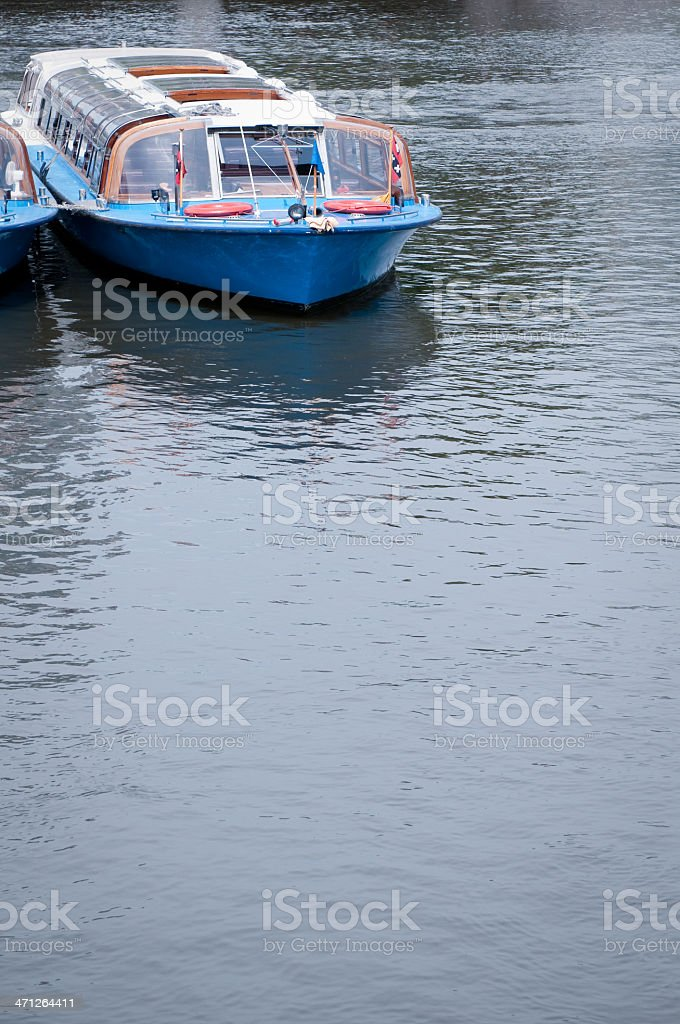 Tourist barge in Amsterdam, boat on canal with copy space royalty-free stock photo