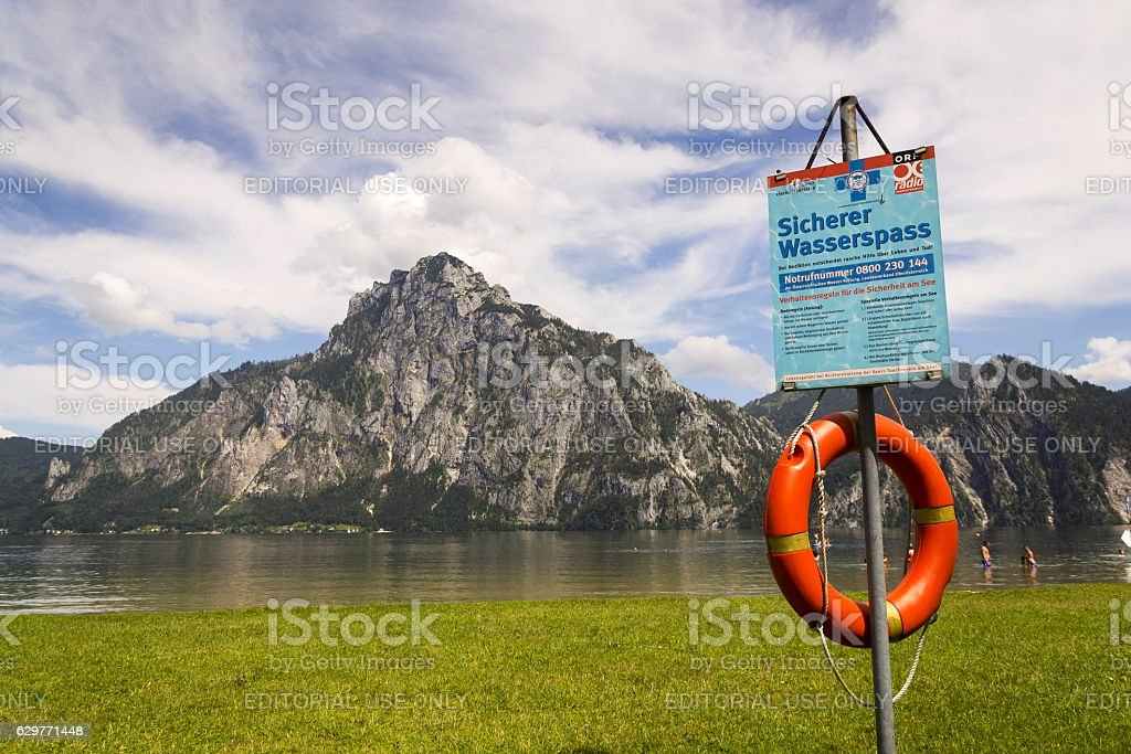 Tourist bath in Traunsee with Traunstein Mountain in background stock photo