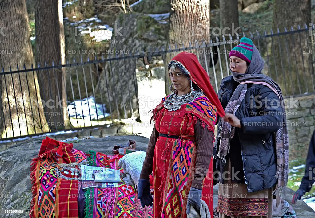 Tourist being Dressed in Traditional Attire of Kullu Valley stock photo