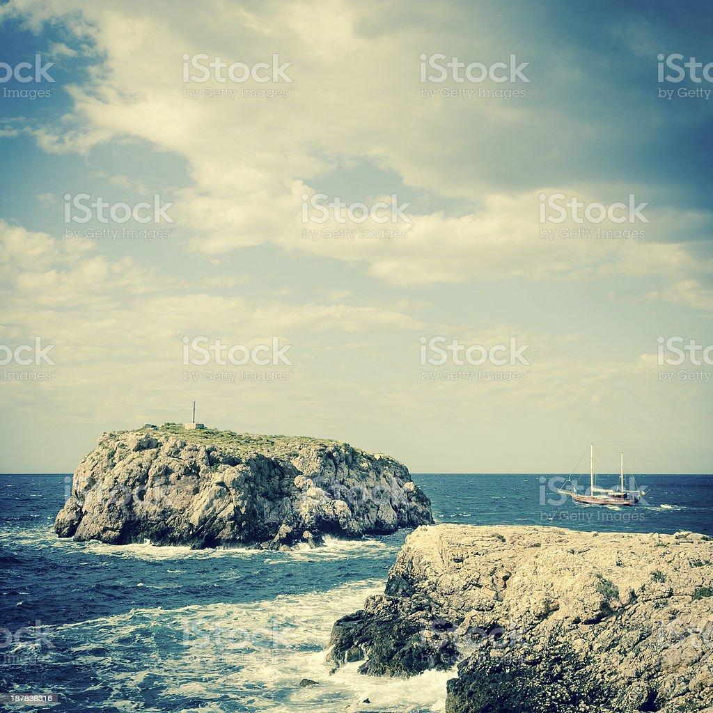 Tourist boat and reef - Adriatic sea stock photo