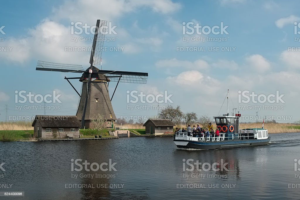 Tourist boat and windmill in Kinderdijk, the Netherlands stock photo