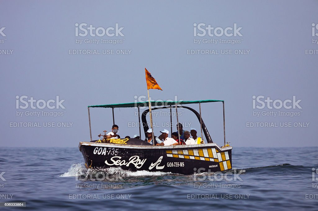 Tourist boat at sea off coast of Goa India stock photo