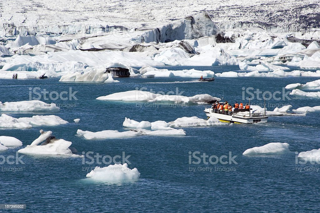 Tourist boat in icebergs in Iceland stock photo