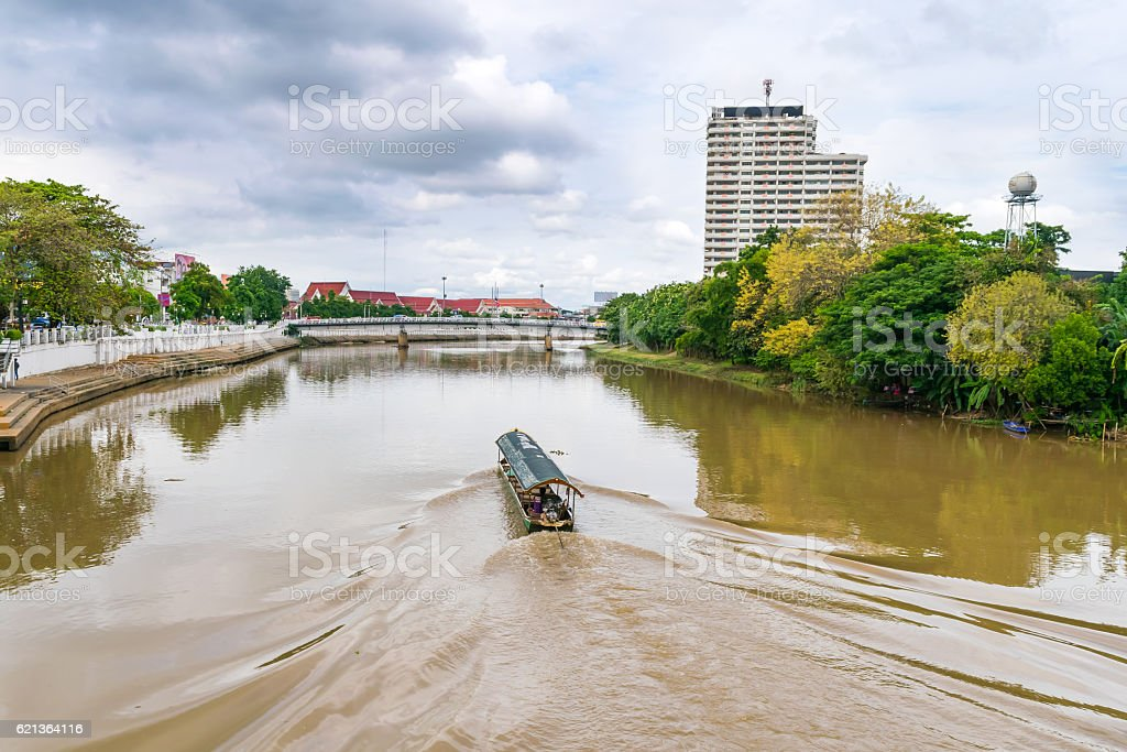 Tourist boat in main river (Ping river) in Chiangmai stock photo