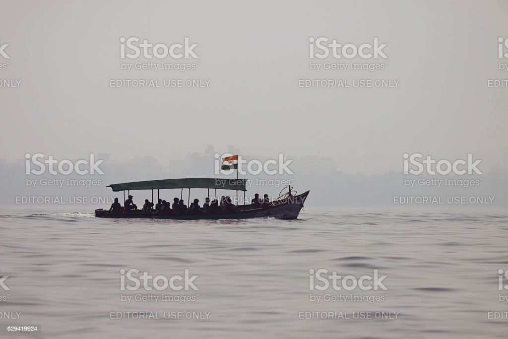 Tourist boat in the middle of sea stock photo
