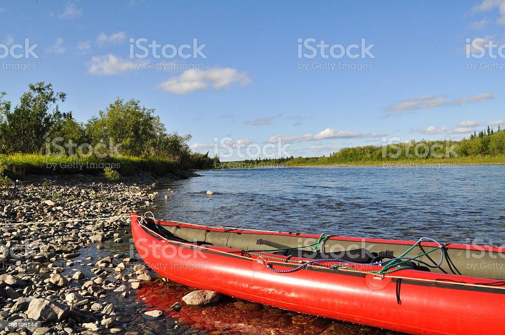 Tourist boat on the pebbly shore. stock photo