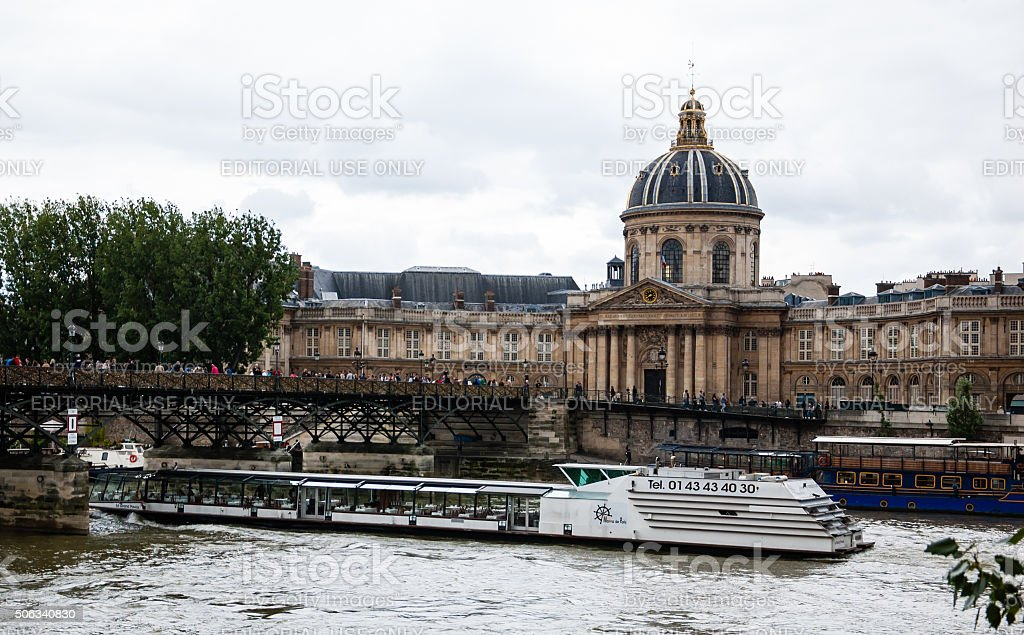 Tourist boat under Lovelocks bridge near Academy of Fine Arts stock photo
