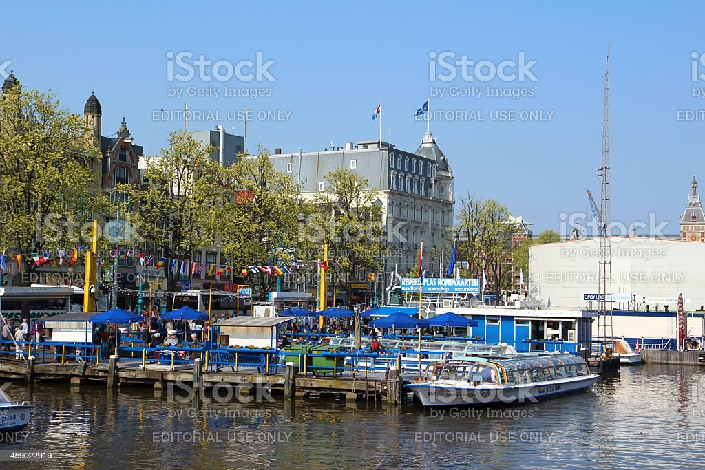 Tourist boats in Amsterdam stock photo