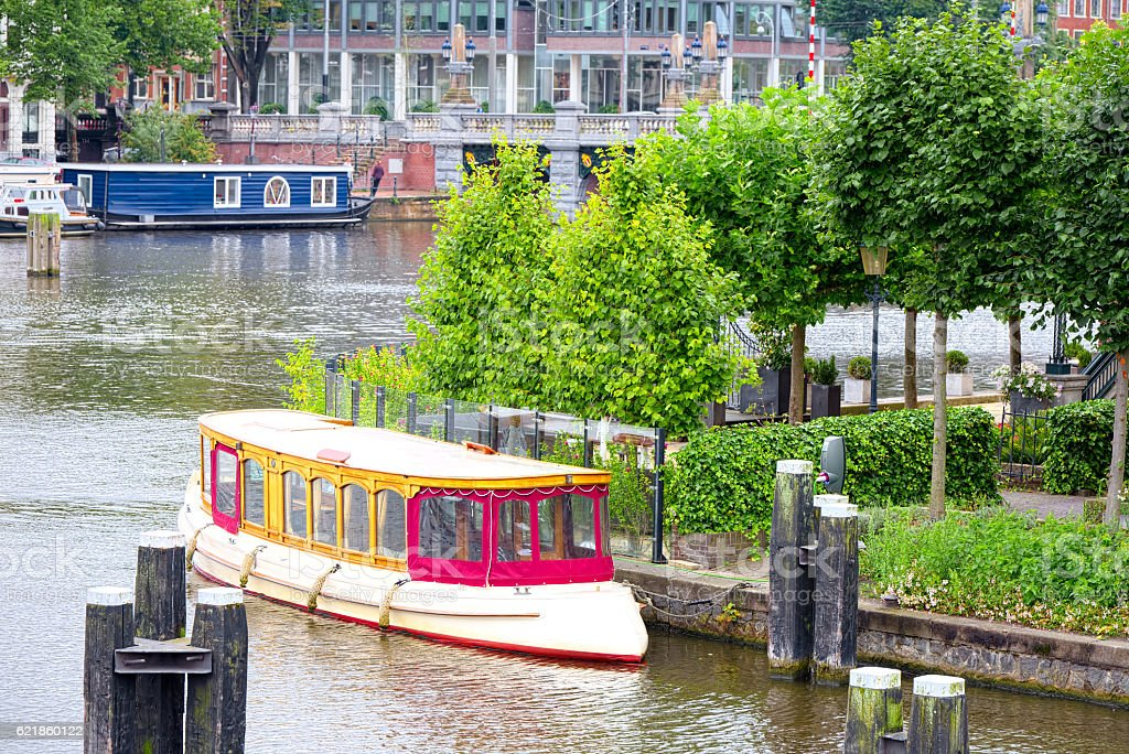 Tourist boats on the Amstel canal, Amsterdam stock photo