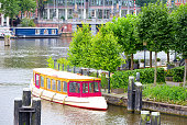 Tourist boats on the Amstel canal, Amsterdam