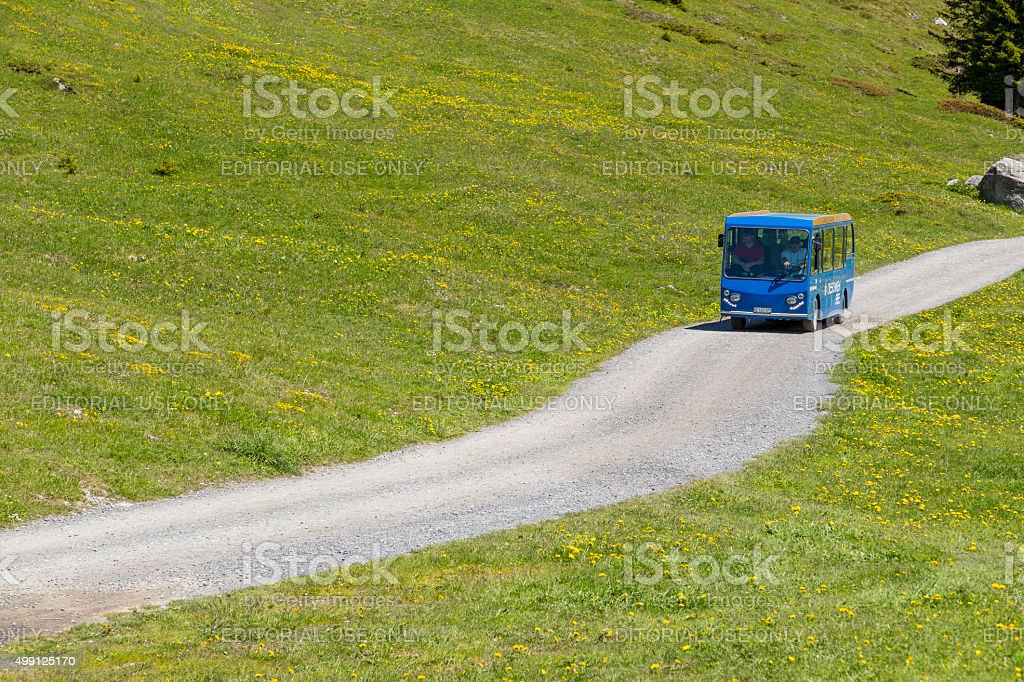 Tourist bus driving along near Oeschinensee Lake, Bernese Oberland, Switzerland stock photo