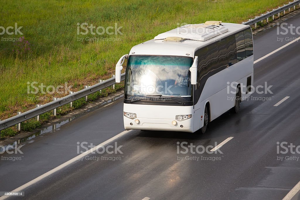 tourist bus goes on country  highway stock photo