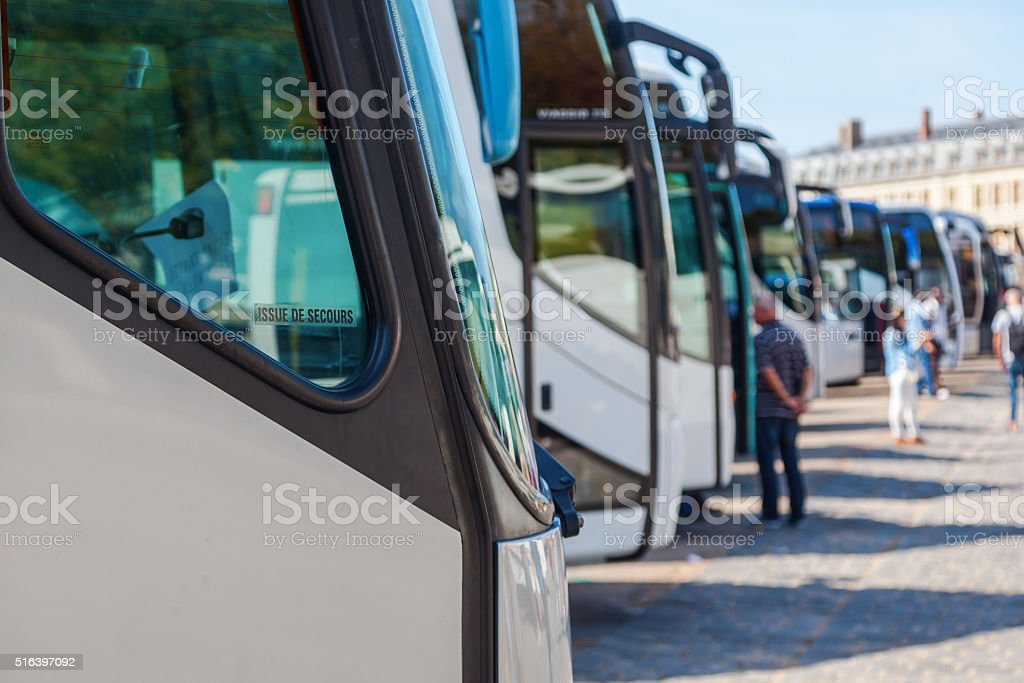 tourist buses in a row stock photo