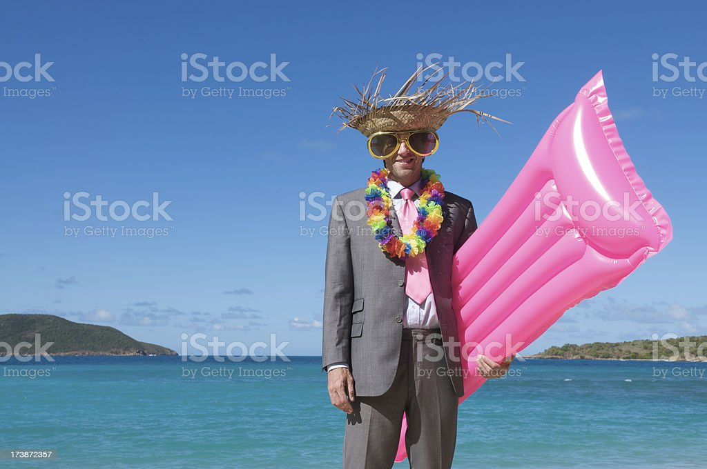 Tourist Businessman Hits the Beach with Bright Pink Raft royalty-free stock photo