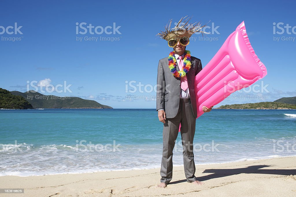Tourist Businessman Stands Bright Pink Lilo Air Mattress Tropical Beach royalty-free stock photo