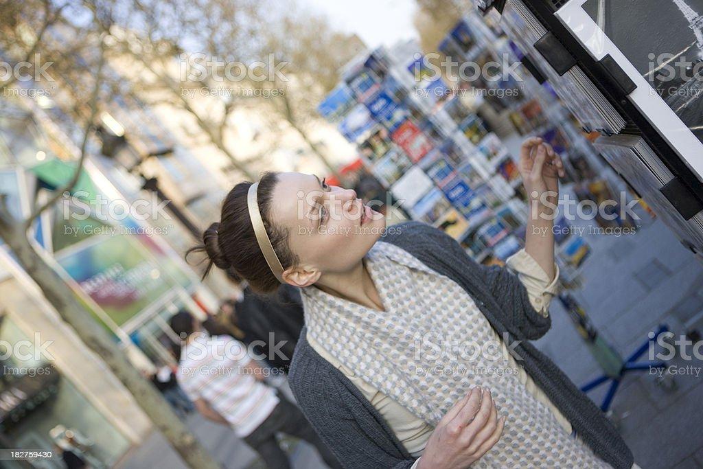 Tourist buying postcards royalty-free stock photo