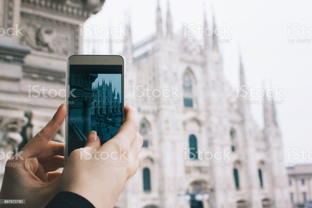 A tourist capturing the Duomo Square with smartphone stock photo