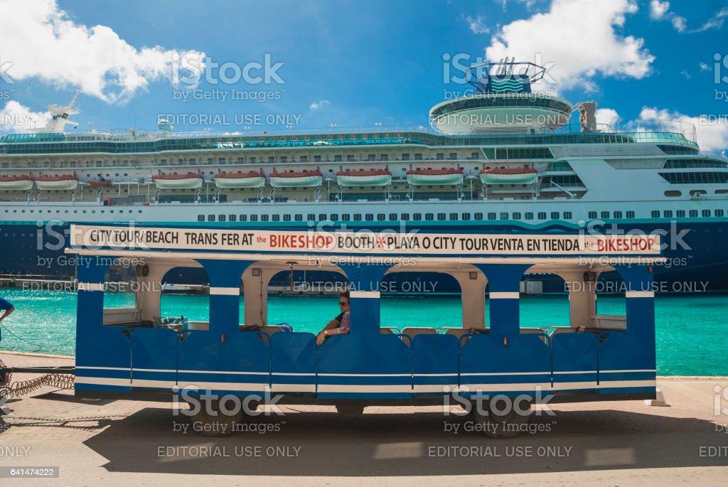 A tourist car and a cruise ship stock photo