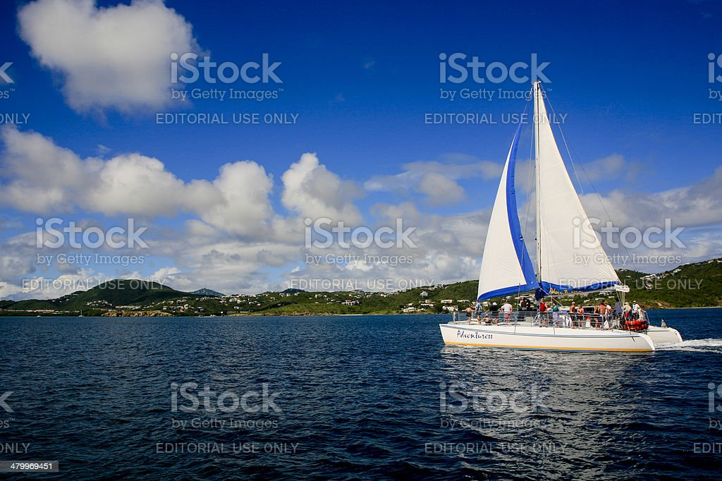 Tourist Catamaran Heading out of the Charlotte Amalie Harbour stock photo