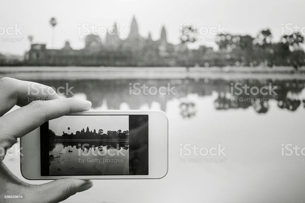 Tourist catching the sunrise at Angkor Wat, Cambodia stock photo