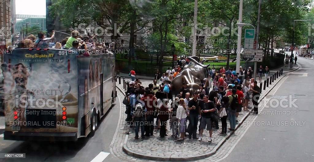 Tourist Checking Out Famous Wall Street Bull In New York.USA stock photo