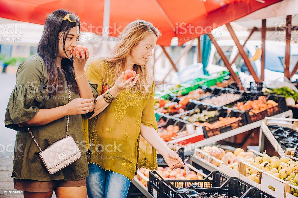 Tourist Checking Street Market Stalls stock photo
