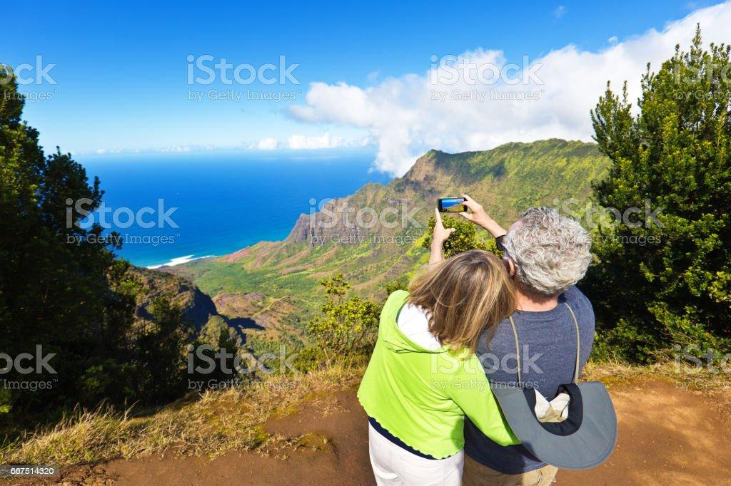 Tourist Couple at Waimea Canyon State Park Kalalau Beach, Kauai, Hawaii stock photo